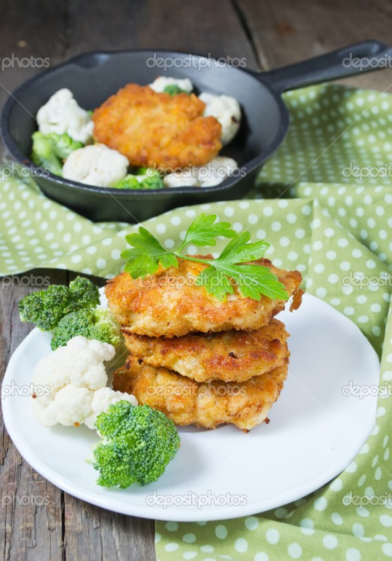 Chicken cutlets with cauliflower and broccoli, selective focus